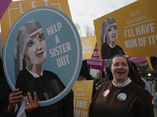 Nuns supporting Little Sisters of the Poor attend a rally in front of the U.S. Supreme Court on March 23.