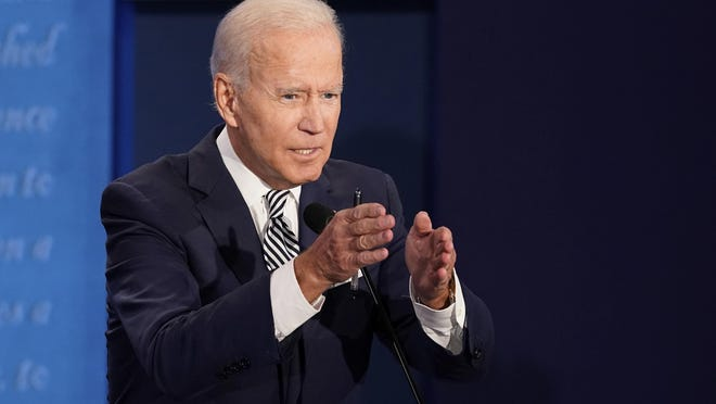 Democratic presidential candidate former Vice President Joe Biden speaks Tuesday night during the first presidential debate against President Donald Trump at Case Western University and Cleveland Clinic, in Cleveland, Ohio.