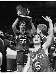 Kevin Rankin (55) holds up the WISAA Class A trophy after De Pere Abbot Pennings' 49-48 overtime win over Milwaukee Marquette in the state championship game on March 3, 1990. Rankin will be inducted into the WBCA Hall of Fame on Saturday.