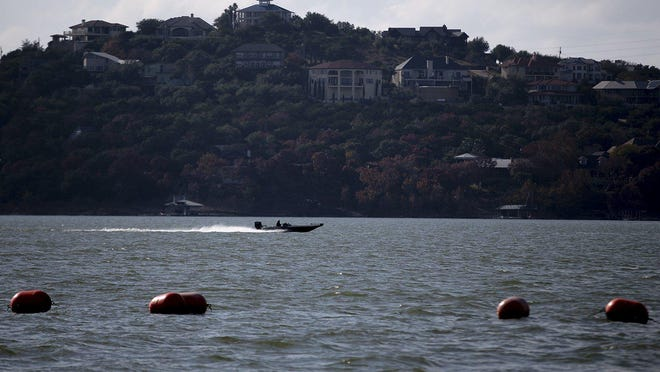 A boat crosses Lake Travis on Nov. 30, 2018. Lake patrol units with the Travis County sheriff's office on Sunday continued their search for a swimmer who was last seen in Lake Travis on Saturday evening.