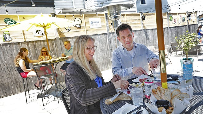 Kathryn and Walter Hubley, of Wollaston, have lunch at The Pour Yard on Monday.