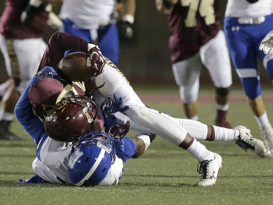 Bowie defensive back Dominic Johnson folds Andress