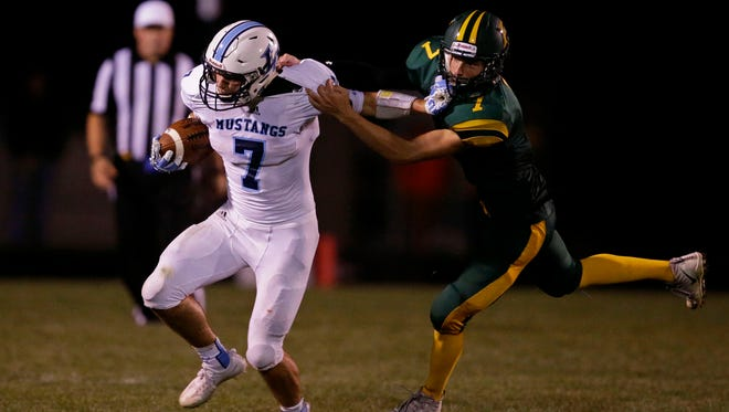 Adam Hietpas of Little Chute is pursued by Reeve Lambrecht of Freedom in a Northeastern Conference football game Friday, August 18, 2017, at Freedom High School in Freedom, Wis.Ron Page/USA TODAY NETWORK- Wisconsin