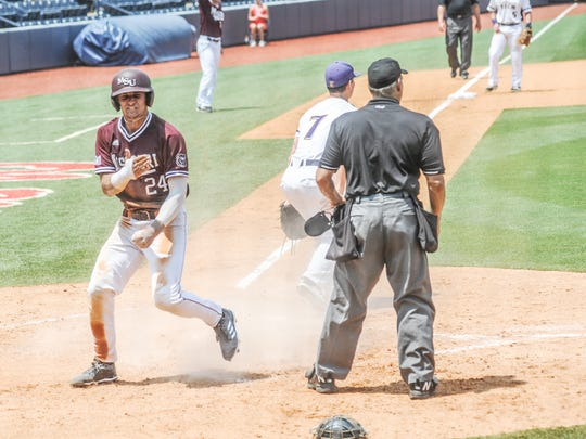 Missouri State catcher Drew Millas (24) celebrates after scoring on a wild pitch against Tennessee Tech in the NCAA Oxford Regional, at Oxford-University Stadium in Oxford, Miss. on Saturday, June 2, 2018. (Bruce Newman, Oxford Eagle via AP)