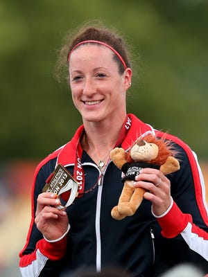 Tatyana McFadden poses with her gold medal in the women's 5000 T54 during day three of the IPC Athletics World Championships on July 22, 2013 in Lyon, France. She was named to the Paralympic team for the Sochi Games.
