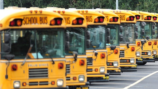 In this file photo, school buses depart the Athens-Clarke school bus depot on Monday, Nov. 16, 2015 in Athens, Ga.