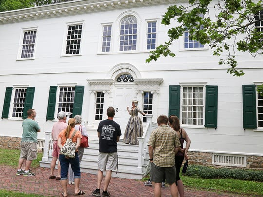 Volunteer Jill Oshita of Clinton, dressed as an upper-class woman in the 1770's period, leads a tour of he Ford Mansion at Washington's Headquarters in Morristown on June 13, 2015.