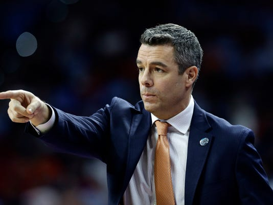 Virginia head coach Tony Bennett speaks to players during the first half of a second-round men's college basketball game in the NCAA Tournament against Butler, Saturday, March 19, 2016, in Raleigh, N.C. (AP Photo/Gerry Broome)