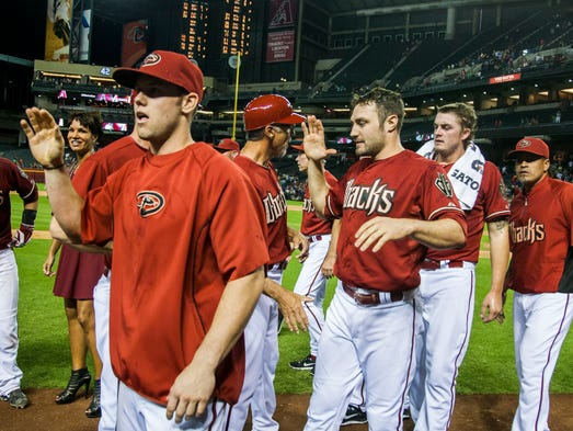 Coaches and players celebrate their win after the Arizona Diamondbacks and Colorado Rockies baseball game at Chase Field on Wednesday, April 30, 2014 in Phoenix, Arizona.