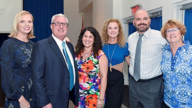 Attending the Library Foundation of Martin County's annual meeting were, from left, Christine DelVecchio, Michael Kenny, Stacy Ranieri, Denise Erich, William Gilcher and Joan Amerling.