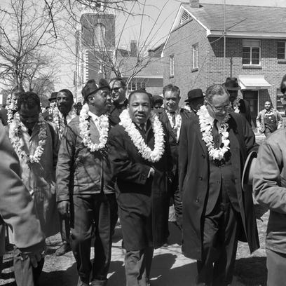 Rev. Martin Luther King Jr., center, walks with fellow