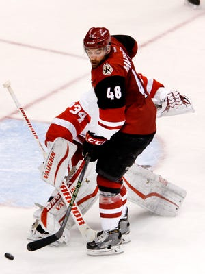 Jordan Martinook of the Coyotes tries to deflect the puck past Red Wings goalie Petr Mrazek during the second period of an NHL game at Gila River Arena in Glendale on Thursday, January 14, 2016.