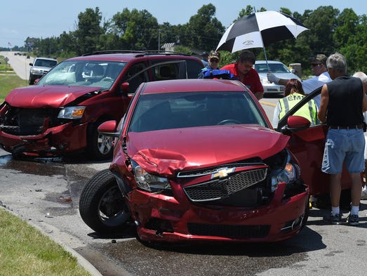Emergency personnel work the scene of a two-vehicle accident Friday at U.S. Highway 62 East near Rolling Meadows. At least one person was taken to the hospital following the wreck.