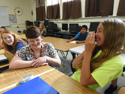 Pinkston Middle School math teacher Kristi Nelson's shares a light moment with Alice Bates on Wednesday during the first day of school.