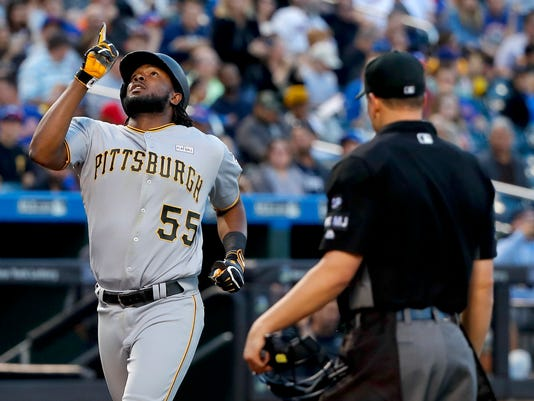 Pittsburgh Pirates' Josh Bell (55) gestures as he approaches home plate after hitting a solo home run against the New York Mets during the second inning of a baseball game, Saturday, June 3, 2017, in New York. (AP Photo/Julie Jacobson)