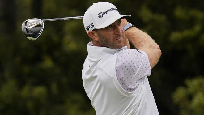 Dustin Johnson watches his tee shot on the 12th hole during the third round of the PGA Championship on Saturday.