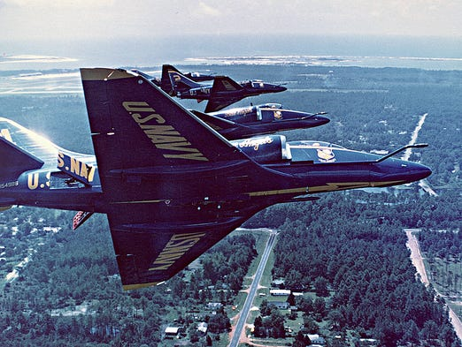 The Blue Angels fly over Pensacola, with Pensacola Naval Air Station and Perdido Key in the background, circa 1970s.