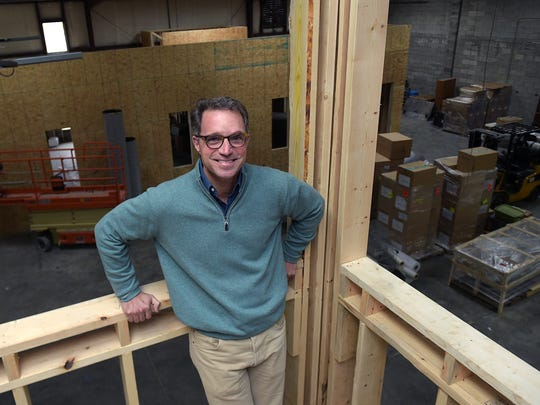 Thistle Farms CEO Hal Cato stands above the company's