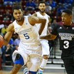 Kentucky guard Andrew Harrison (5) brings the ball up court against Mississippi State guard Trivante Bloodman (3) Wednesday during their game at Humphrey Coliseum in Starkville.
