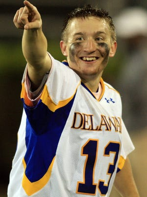 Delaware goalkeeper Noah Fossner celebrates after the Blue Hens beat Drexel in the semifinals of the Colonial Athletic Association playoffs at Delaware Stadium in 2010.