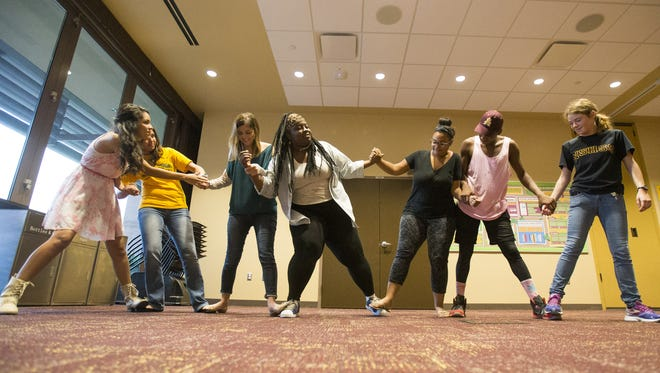 Eunice Dominguez Chacon, Breanna Carpenter, Ryan Jordan, Keiosha Lee, Mikayla Miller, Dale Vaugh and Gayle Hoefer play a game during a Bridging Success event at ASU Sept. 22, 2015.
