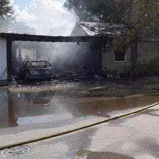 A homeowner arrived home to see smoke under his car that then caught fire and damaged the house.