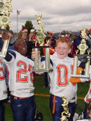 Corey Davis and Ryan Graham celebrate after a youth