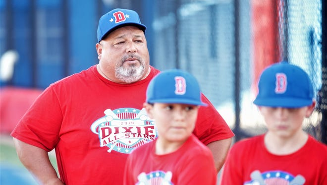 Dixie coach Randy Castillo watches as his players return to practice after a meeting Wednesday at the Dixie baseball field. The Dixie 9-11 team will open the Texas West State Little League tournament against East Brownsville at 8:30 p.m. Saturday at Lake Kirby Park.