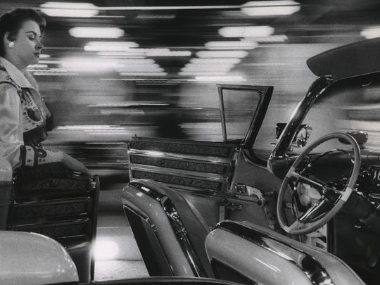 """A six-gun equipped Buick """"Wells Fargo"""" convertible - custom-built for Dale Robertson, star of the NBC TV Western """"Tales of Wells Fargo,"""" is shown on display at the 1958 Greater Milwaukee Auto Show at the Milwaukee Auditorium and Arena. The car's hand-tooled leather interior was fitted with pistol holsters. This photo was published in the Feb. 13, 1958, Milwaukee Journal."""