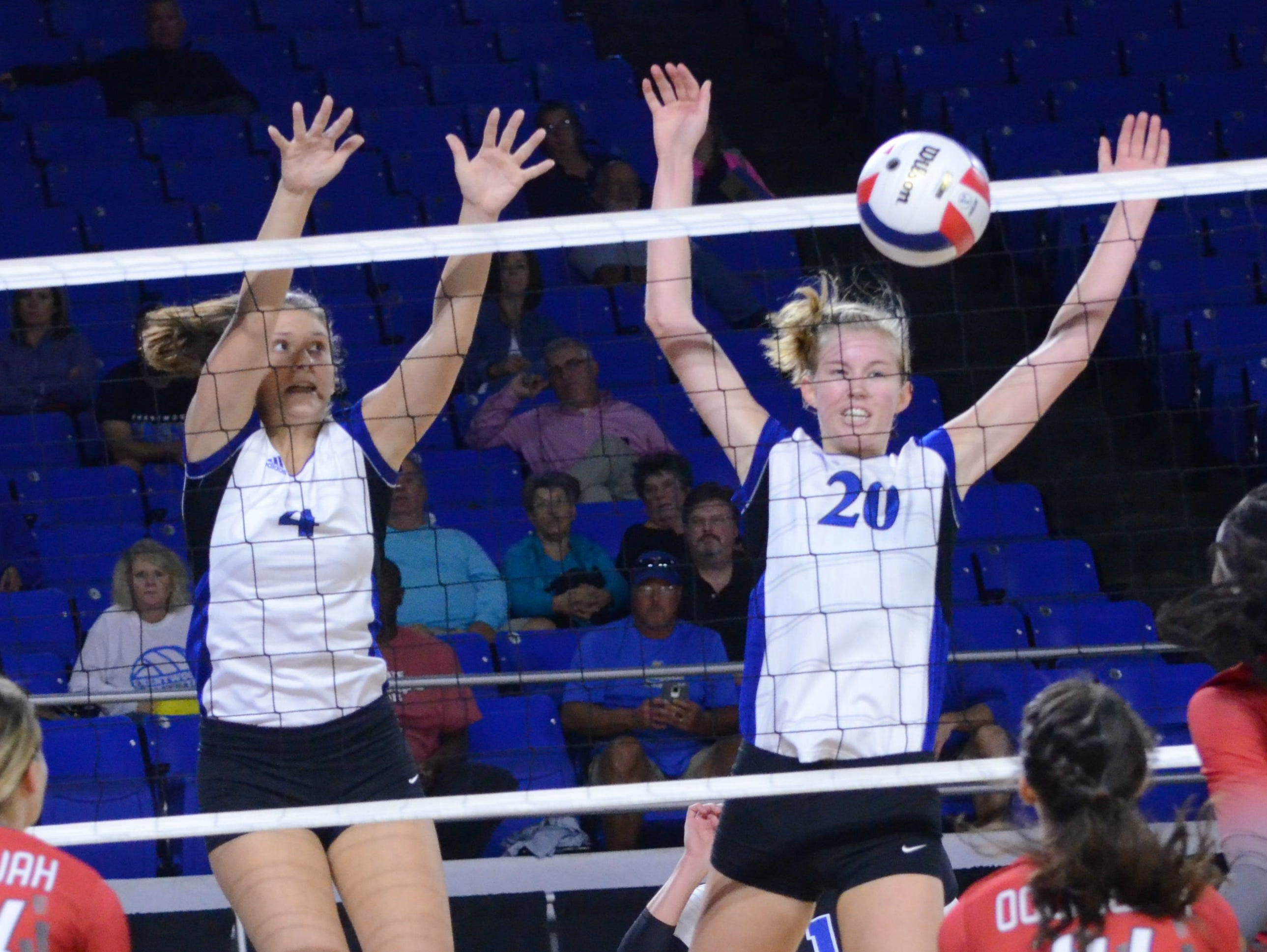 Brentwood's Megan Jantzi (4) and teammate Garrett Joiner (20) block an Ooltewah kill attempt during the Lady Bruins' 3-0 opening-round win at the Class AAA State Volleyball Championships.