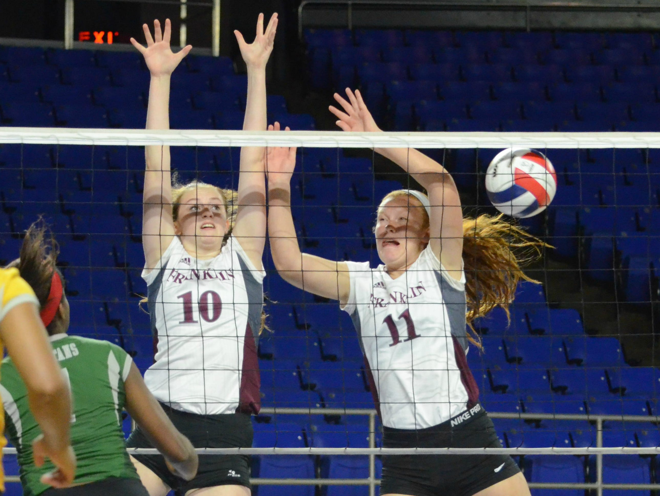 Franklin's Mackenzie LePage (10) and Jodi Hill (11) attempt to block a White Station shot during Wednesday evening's Class AAA elimination match.