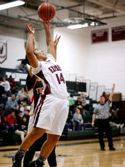 Tairra Jenkins reaches backward to tip the ball to