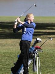 Rachel Hoferer of Mercy watches her ball fly toward