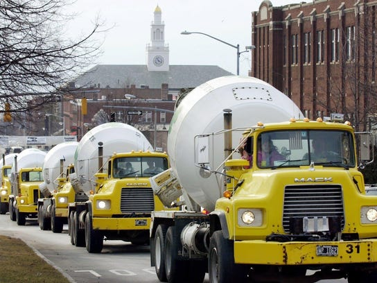 Air-horns blaring, a procession of trucks from the S.D. Ireland Concrete Construction Co. parades up Main Street in Burlington to celebrate St. Patrick's Day 2002.