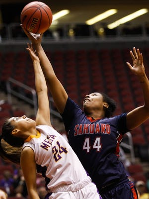 Mesa's Lesly Martinez, left, and Sahuaro's Sydney Harden go up for a rebound during the Division II girls basketball state semifinals on Tuesday at Gila River Arena. Mesa beat Sahuaro 35-24.