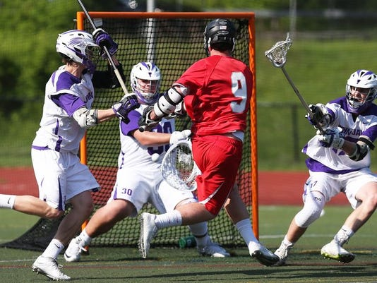 John Jay defeated Somers 12-5 in a boys playoff lacrosse game at John Jay High School in Cross River May 19, 2015.   Frank Becerra Jr./The Journal News