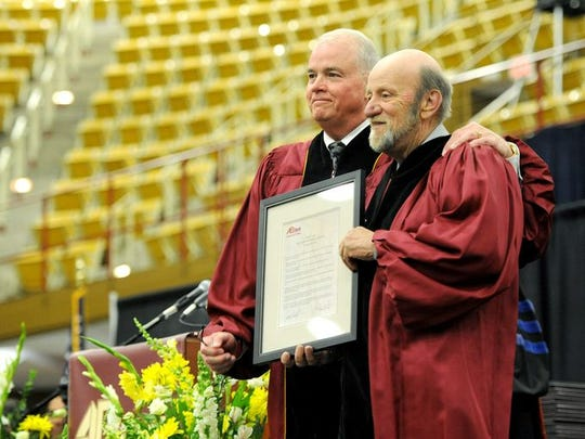 Buncombe County Commissioner Mike Fryar, right, stands with Joe Brumit, chairman of the board at Asheville-Buncombe Technical Community College, at the May 16, 2015 graduation ceremony where Fryar was awarded an honorary degree.