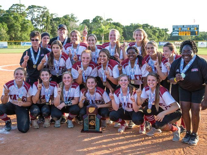 Tate Aggies teammates celebrate their Class 7A state softball championship over Sarasota High School at Historic Dodgertown in Vero Beach in May.