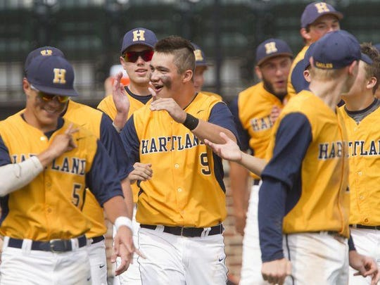 """Gary Turnbull, who drove in two runs Thursday, is confident in his team's chances on Saturday. """"We're going to win the state championship,"""" he said. """"That's my prediction. We're going to win this and bring it back for Hartland."""""""