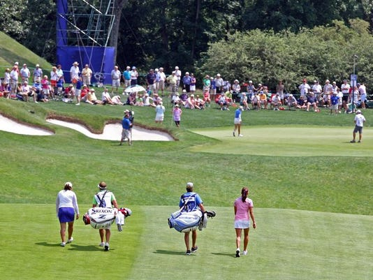 Inbee Park and Lexi Thompson walk to their balls as golfers play the 13th green during the second round of the KPMG Women's PGA Championship at Westchester Country Club June 12, 2015.  (Photo: Seth Harrison/The Journal News)