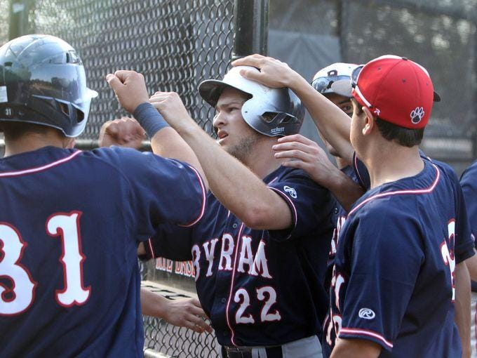 Byram Hills' Frankie Vesuvio (22) is greeted by teammates after hitting a solo home run against Rye during a baseball game at Disbrow Park in Rye May 12, 2015. Byram Hills won the game 15-2.
