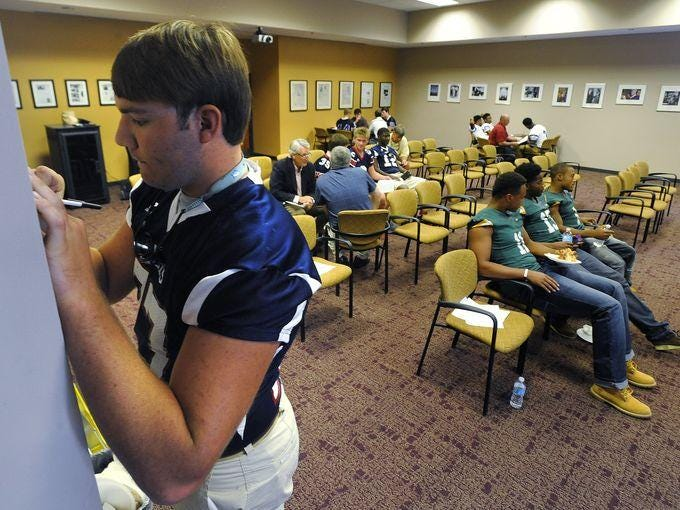 Former Montgomery Academy player Tyler Mitchell fills in a questionnaire last year at the Montgomery Advertiser High School Football Media Day. Mitchell signed with Kansas State in February. The Advertiser hosts its seventh Media Day Thursday.