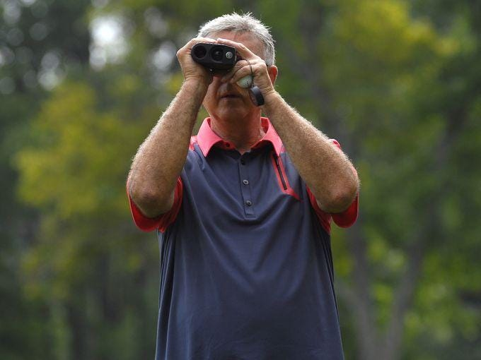 Joe Mericka checks the distance at the second hole July 12 during the Port Huron Elks Men's Invitational.