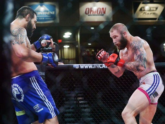Jordan Larson of Sioux Falls, right, faces off against Ackson Junior of Brazil in a RFA 29, Resurrection Fighting Alliance fight Friday night at the Sanford Pentagon, Aug 21, 2015.