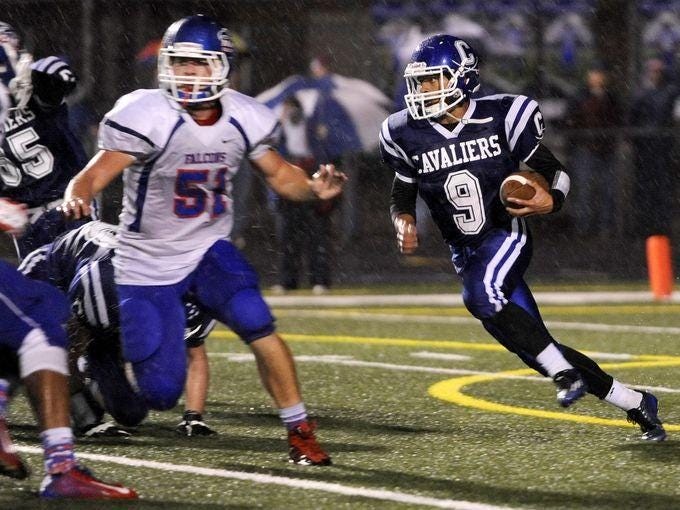 Chillicothe's Quintin Davidson carries the ball against Clinton-Massie at Chillicothe's Herrnstein Field.