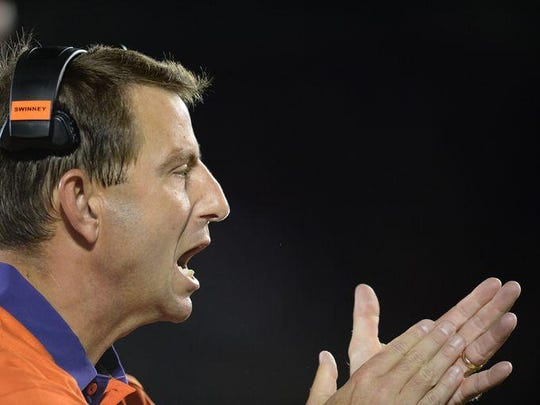 Clemson coach Dabo Swinney urges his team on Thursday night at Louisville.