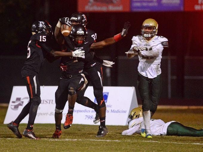 Mississippi State signee C.J. Morgan celebrates a touchdown pass in the end zone as the final seconds tick off the clock to end the first half of the Panther's Class 5A second-round playoff game against Acadiana.
