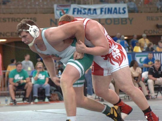 Leon senior Gabe Beyer wrestles Fort Myers senior Mike Delago in the FHSAA Class 2A state finals at 285 pounds on Saturday night. Beyer won 4-3 to win a state title.
