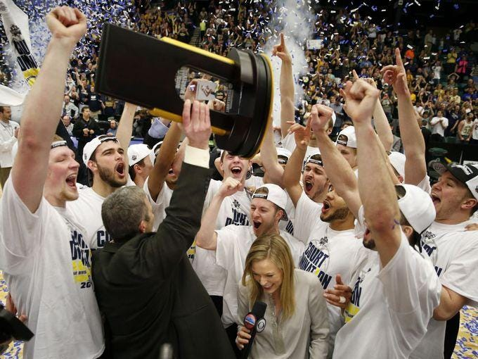Augustana celebrates a victory over Lincoln Memorial in the 2016 Division II National Championship Game at Dr Pepper Arena in Frisco on Saturday, March 26, 2016. Augustana defeated Lincoln Memorial 90-81 to win the championship.