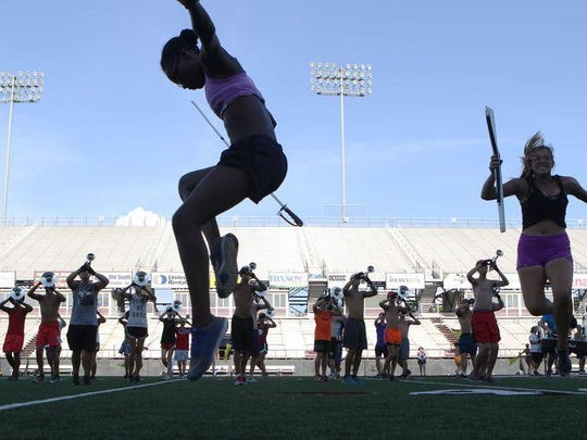 Louisiana Stars Drum and Bugle Corps members rehearse in temps reaching 100 at Malone Stadium. The corps will show off their skills at 8 p.m. Thursday at the stadium at the University of Louisiana at Monroe. Admission is free.